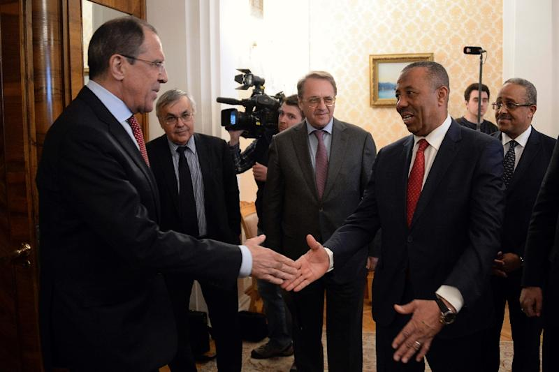Russian Foreign Minister Sergei Lavrov (L) welcomes Libyan Prime Minister Abdullah al-Thani during their meeting in Moscow on April 15, 2015