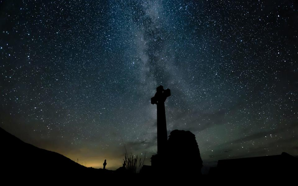 The ruins of the abbey at night - Getty