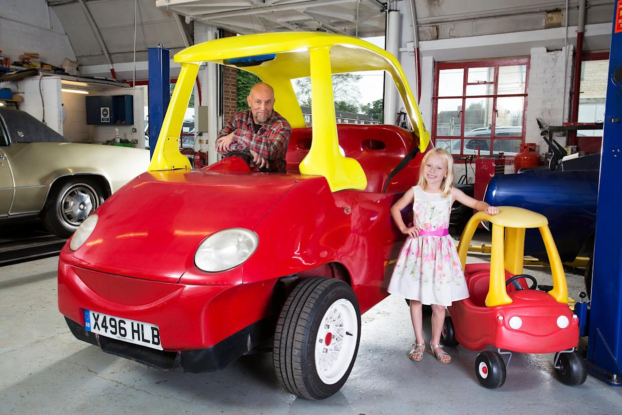 Brits Geof Bitmead (pictured) and John Bitmead built the world's largest Cozy Coupe: 8 feet, 10.2 inches.&nbsp;<br>