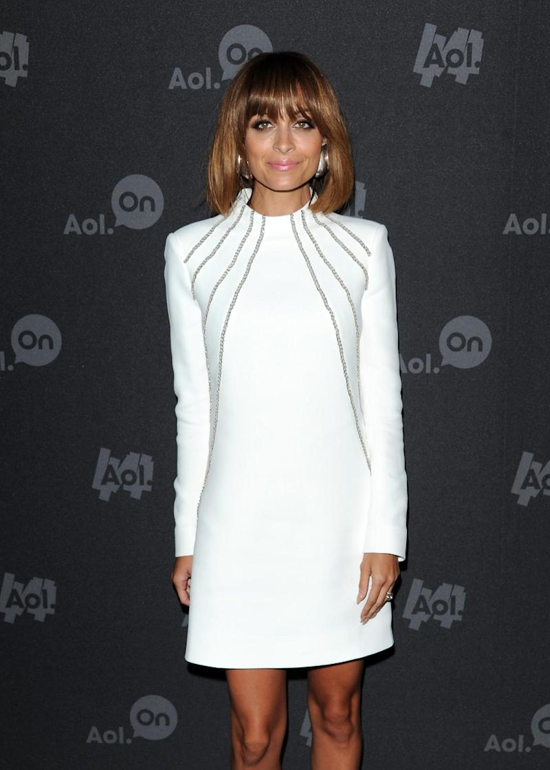 """FILE - This April 30, 2013 file photo shows television personality Nicole Richie at AOL's web series NewFront to promote her series """"#CandidlyNicole"""" in New York. The first webisode, where 31-year-old Richie consults with a doctor about having her """"tramp stamp"""" (or tattoo on her lower back) removed, earned 1 million views in just its first week. (Photo by Evan Agostini/Invision/AP, file)"""
