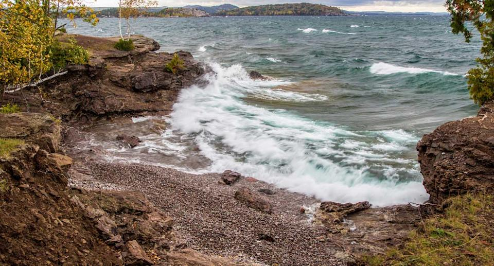 The rugged coast of Lake Superior with cliffs and coves located in Presque Isle Park in the Upper Peninsula of Michigan.
