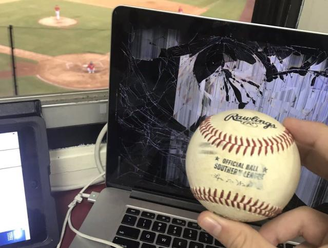 Roger Hoover's laptop was destroyed by a baseball while he was on the air calling a minor league game. (Twitter/@Roger_Hoover)