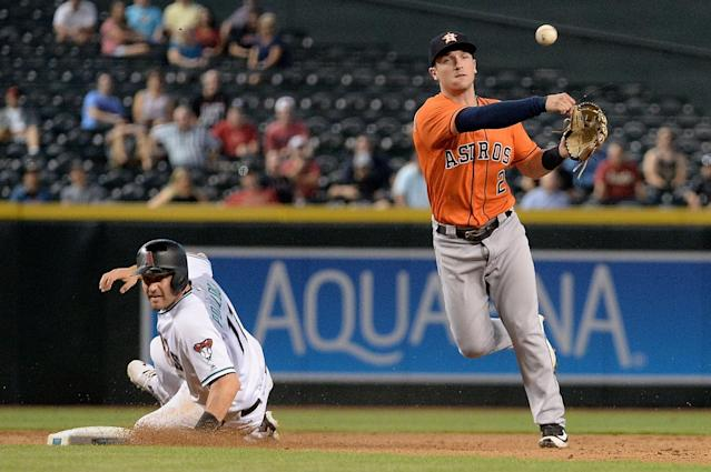 <p>PHOENIX, AZ – AUGUST 15: Alex Bregman #2 of the Houston Astros turns a double play over over the sliding A.J. Pollock #11 of the Arizona Diamondbacks in the seventh inning at Chase Field on August 15, 2017 in Phoenix, Arizona. (Photo by Jennifer Stewart/Getty Images) </p>