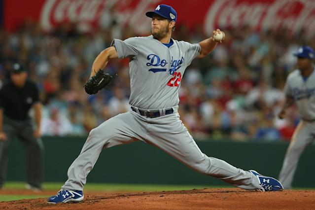 SYDNEY, AUSTRALIA - MARCH 22: Clayton Kershaw of the Dodgers pitches during the opening match of the MLB season between the Los Angeles Dodgers and the Arizona Diamondbacks at Sydney Cricket Ground on March 22, 2014 in Sydney, Australia. (Photo by Mark Kolbe/Getty Images)