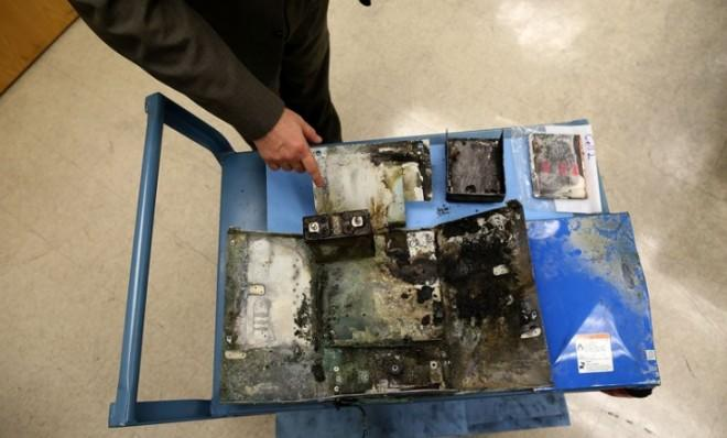 The charred box from a Japan Airlines 787 in which the battery caught fire, is displayed.