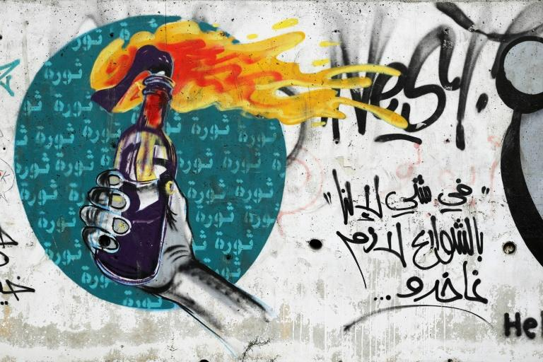 Graffiti has enveloped Beirut since an anti-government protest movement began a month ago (AFP Photo/JOSEPH EID)