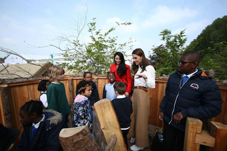 "<p>The Duchess of Cambridge met with a group of children to unveil the garden she co-designed for the Royal Chelsea Flower Show in May 2019. The Back to Nature Garden, as it was titled, had a strong tie to <a href=""https://www.royal.uk/duchess-Cambridge-rhs-back-nature-garden"" rel=""nofollow noopener"" target=""_blank"" data-ylk=""slk:Middleton's previous initiatives"" class=""link rapid-noclick-resp"">Middleton's previous initiatives</a> regarding nature's impact on early childhood development. </p>"