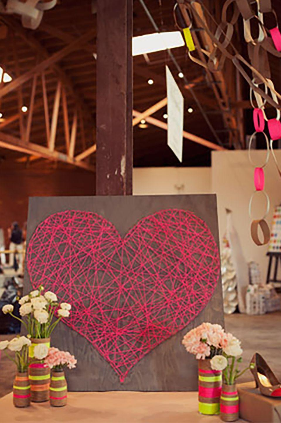 """<p>Pull on the heart strings of your loved one with this lovely piece of art. Just latch red string around nails arranged in a heart shape. </p><p><strong>Get the tutorial at <a href=""""http://greenweddingshoes.com/diy-string-heart/"""" rel=""""nofollow noopener"""" target=""""_blank"""" data-ylk=""""slk:Green Wedding Shoes"""" class=""""link rapid-noclick-resp"""">Green Wedding Shoes</a>.</strong> </p><p><strong><a class=""""link rapid-noclick-resp"""" href=""""https://www.amazon.com/s/ref=nb_sb_noss_2?url=search-alias%3Daps&field-keywords=pink+thread&rh=i%3Aaps%2Ck%3Apink+thread&tag=syn-yahoo-20&ascsubtag=%5Bartid%7C10050.g.2971%5Bsrc%7Cyahoo-us"""" rel=""""nofollow noopener"""" target=""""_blank"""" data-ylk=""""slk:SHOP PINK THREAD"""">SHOP PINK THREAD</a><br></strong></p>"""
