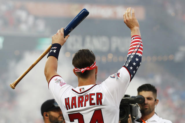 Washington Nationals Bryce Harper (34) waves to fans during the MLB Home Run Derby, at Nationals Park, Monday, July 16, 2018 in Washington. The 89th MLB baseball All-Star Game will be played Tuesday. (AP Photo/Alex Brandon)