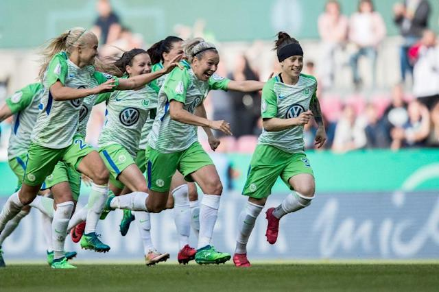Wolfsburg players celebrate beating Bayern Munich in the German Cup final (AFP Photo/Marcel Kusch)