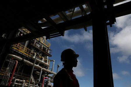 FILE PHOTO: A worker walks inside the Brazil's Petrobras P-66 oil rig in the offshore Santos Basin in Rio de Janeiro