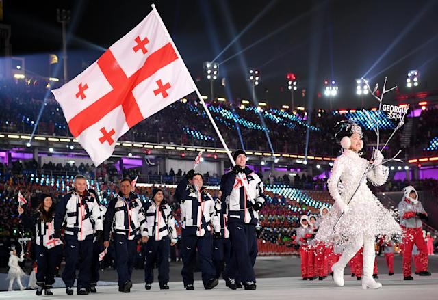 <p>Flag bearer Morisi Kvitelashvili of Georgia and teammates enter the stadium during the Opening Ceremony of the PyeongChang 2018 Winter Olympic Games at PyeongChang Olympic Stadium on February 9, 2018 in Pyeongchang-gun, South Korea. (Photo by Matthias Hangst/Getty Images) </p>