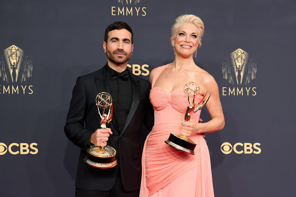 """""""Ted Lasso"""" stars Brett Goldstein and Hannah Waddingham pose with their new awards at the 73rd Primetime Emmy Awards."""