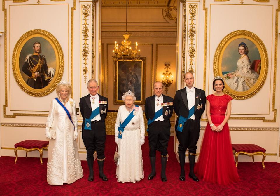 Queen Elizabeth II, the Duke of Edinburgh, the Prince of Wales, the Duchess of Cornwall and the Duke and Duchess of Cambridge arrive for the annual evening reception for members of the Diplomatic Corps at Buckingham Palace, London. PRESS ASSOCIATION Photo. Picture date: Thursday December 8, 2016.