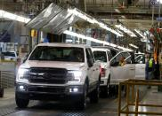 FILE PHOTO: Newly assembled Ford F150 pick-up trucks are driven off the assembly line during the 100-year celebration of the Ford River Rouge Complex in Dearborn