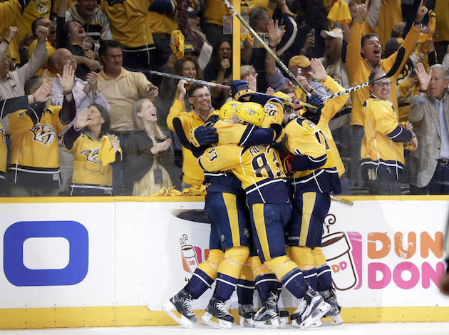 """<a class=""""link rapid-noclick-resp"""" href=""""/nhl/teams/nas/"""" data-ylk=""""slk:Nashville Predators"""">Nashville Predators</a> players celebrate after scoring a goal against the Anaheim Ducks in the third period of Game 6 of the Western Conference final in the NHL hockey Stanley Cup playoffs Monday, May 22, 2017, in Nashville, Tenn. The Predators won 6-3 to win the series 4-2 and advance to the Stanley Cup Finals. (AP Photo/Mark Humphrey)"""