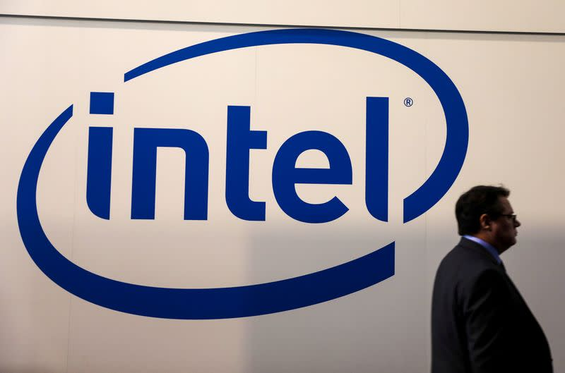 FILE PHOTO: A visitor passes an Intel logo at the Mobile World Congress in Barcelona
