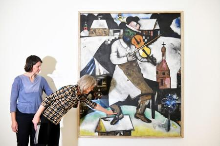 Conservators Meta Chavannes and Madeleine Bisschoff speak about a study on a collection of Marc Chagall's artwork in the conservation atelier of the Stedelijk Museum in Amsterdam