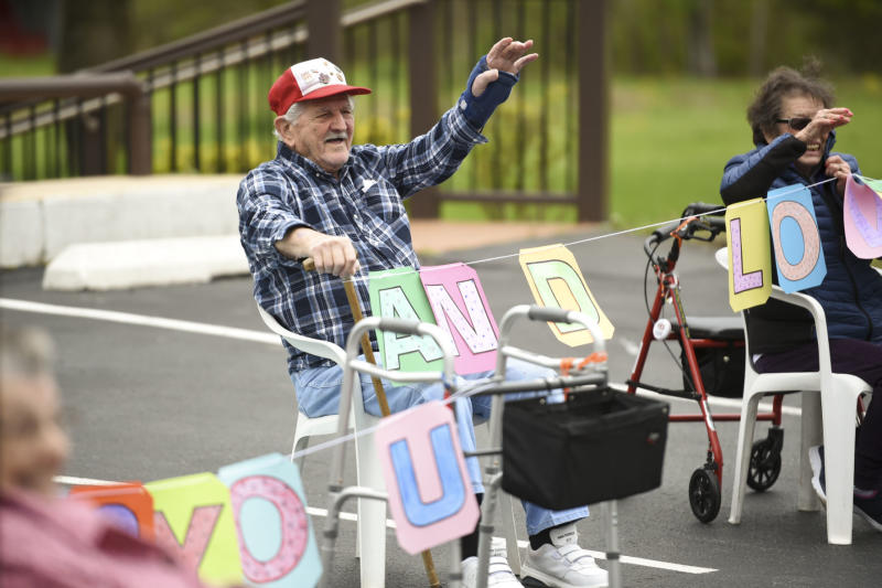 Exeter Township, PA - May 6: Birdsboro Lodge resident Joe Pinder waves at a parade of family members drive by cheering and clapping on Tuesday, May 5, 2020 to cheer up residents unable to see family members due to social distancing during the coronavirus outbreak. (Photo by Lauren A. Little/MediaNews Group/Reading Eagle via Getty Images)