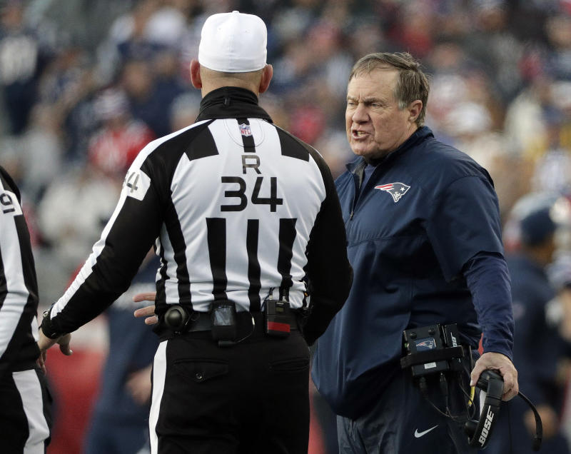 New England Patriots head coach Bill Belichick, right, argues a call with referee Clete Blakeman last season. (AP)