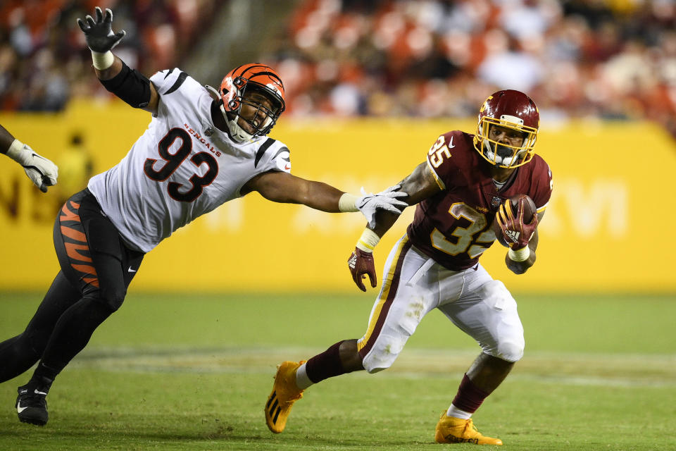 Washington Football Team running back Jaret Patters (35) gets away from Cincinnati Bengals defensive end Amani Bledsoe (93) during the second half of a preseason NFL football game Friday, Aug. 20, 2021, in Landover, Md. (AP Photo/Nick Wass)