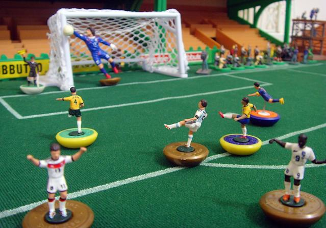 Subbuteo-like figurines made by British artist Terry Lee, who lives in Brazil, on display in his studio outside Rio de Janeiro on June 19, 2014 (AFP Photo/)