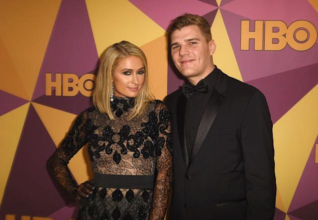 Paris Hilton and Chris Zylka attend a Golden Globes after-party. (Photo: FilmMagic/FilmMagic for HBO)