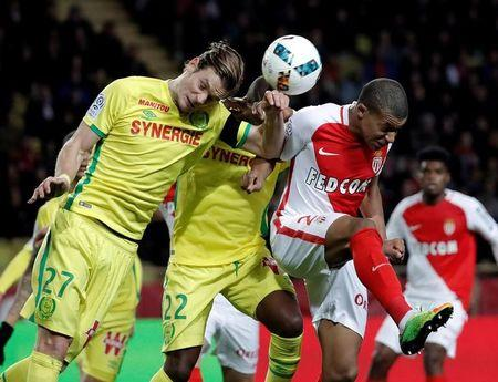 Football Soccer - Monaco v Nantes - French Ligue 1 - Louis II Stadium, Monaco - 5/03/2017 - Monaco's Kylian Mbappe in action with Nantes' Guillaume Gillet.  REUTERS/Eric Gaillard