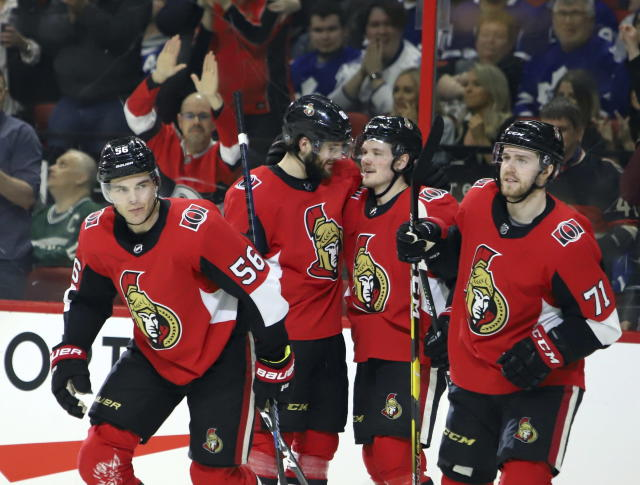 Ottawa Senators left wing Magnus Paajarvi (56) celebrates with teammates after scoring against the Toronto Maple Leafs in the second period of an NHL hockey game in Ottawa, Saturday, March 16, 2019. (Fred Chartrand/The Canadian Press via AP)