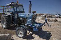 A tractor with a shattered windshield and flat tires following a settlers' attack from nearby settlement outposts on the Palestinian Bedouin community, in the West Bank village of al-Mufagara, near Hebron, Thursday Sept. 30, 2021. An Israeli settler attack last week damaged much of the village's fragile infrastructure. (AP Photo/Nasser Nasser)