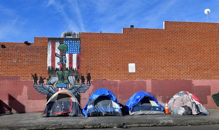 <p>LA mayor urged to rent 15,000 hotel rooms for homeless residents</p> (Photo by FREDERIC J. BROWN/AFP via Getty Images)