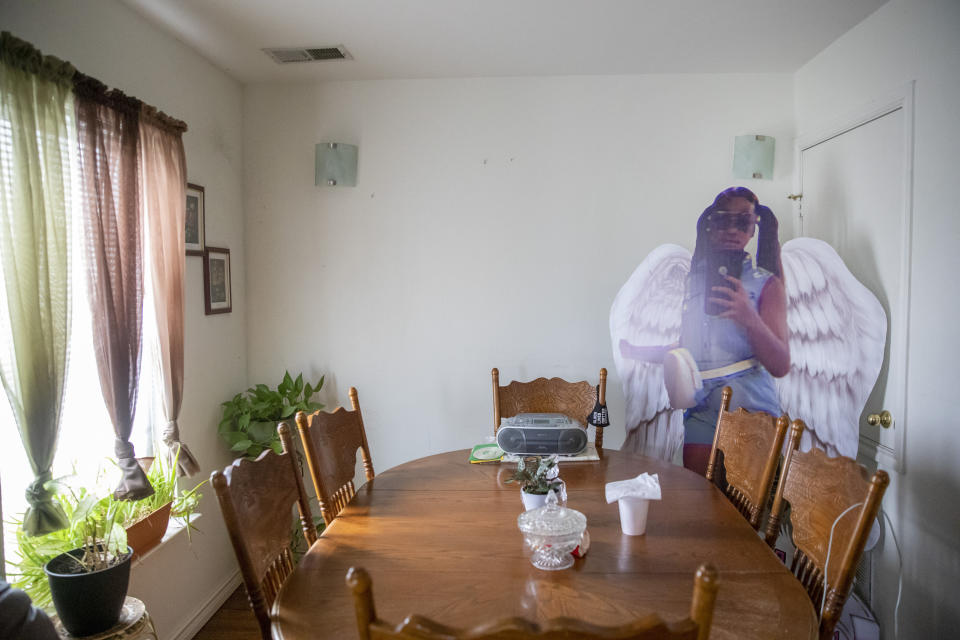 A cutout of twelve-year-old Todriana Peters is placed in a corner at the home of Bonnie Peters in New Orleans, Thursday, July 8, 2021. Todriana Peters was shot and killed outside a graduation party on Memorial Day Weekend in the Lower 9th Ward neighborhood. Homicide rates in many American cities have continued to rise although not as precipitously as the double-digit jumps seen in 2020 and still below the violence of the mid-90s. (AP Photo/Sophia Germer)