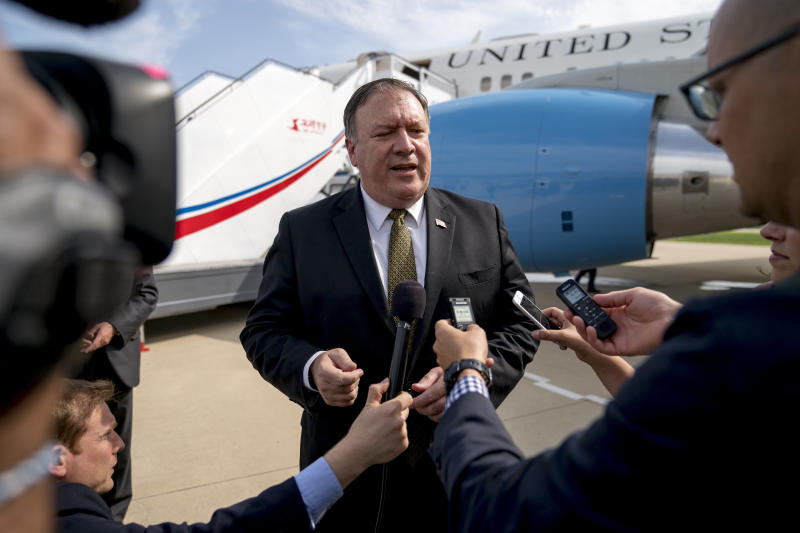 """U.S. Secretary of State Mike Pompeo speaks to members of the media following two days of meetings with Kim Yong Chol, a North Korean senior ruling party official and former intelligence chief, before boarding his plane at Sunan International Airport in Pyongyang, North Korea, Saturday, July 7, 2018, to travel to Japan. Pompeo described the meetings as """"productive, good faith negotiations"""" in the ongoing effort towards denuclearization, and plans have been set to discuss the process of repatriation of remains next week in Panmunjom. (AP Photo/Andrew Harnik, Pool)"""