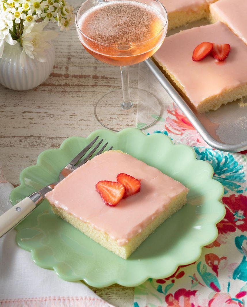 """<p>This strawberry dessert is so pretty you might not want to eat it — but you definitely should. </p><p><em>Get the recipe from <a href=""""https://www.thepioneerwoman.com/food-cooking/recipes/a36210775/strawberries-and-rose-sheet-cake-recipe/"""" rel=""""nofollow noopener"""" target=""""_blank"""" data-ylk=""""slk:The Pioneer Woman"""" class=""""link rapid-noclick-resp"""">The Pioneer Woman</a>.</em></p>"""