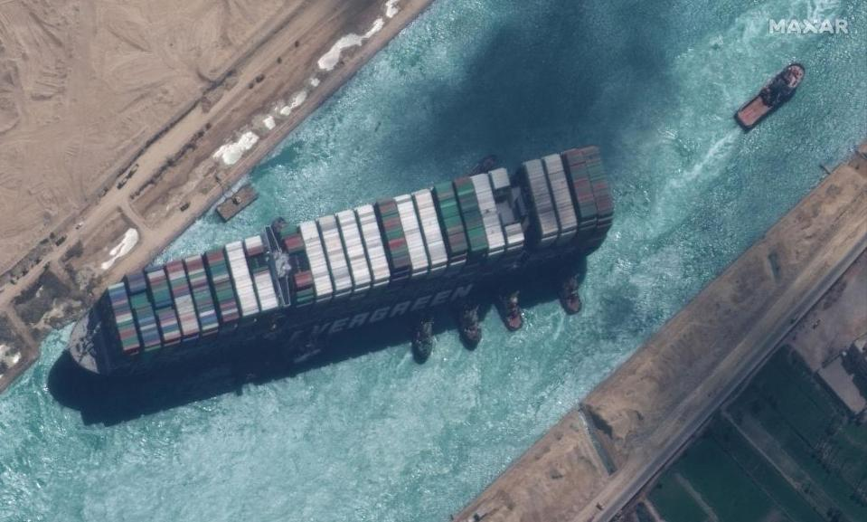 STUCK SHIP EVER GIVEN, SUEZ CANAL -- MARCH 29, 2021:  Maxar new high-resolution satellite imagery of the Suez canal and the container ship (EVER GIVEN) and tugboats that have the ship nearly unstuck north of the city of Suez, Egypt.