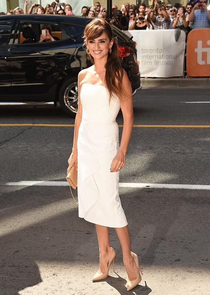 <p>Less than 24 hours after attending the Carolina Herrera fashion show at New York City's Frick Museum, the Spanish actress attended the 'Ma Ma' premiere during the 2015 Toronto International Film Festival in a white strapless dress. While simple, she looked fresh and fabulous despite hours of travel.</p>
