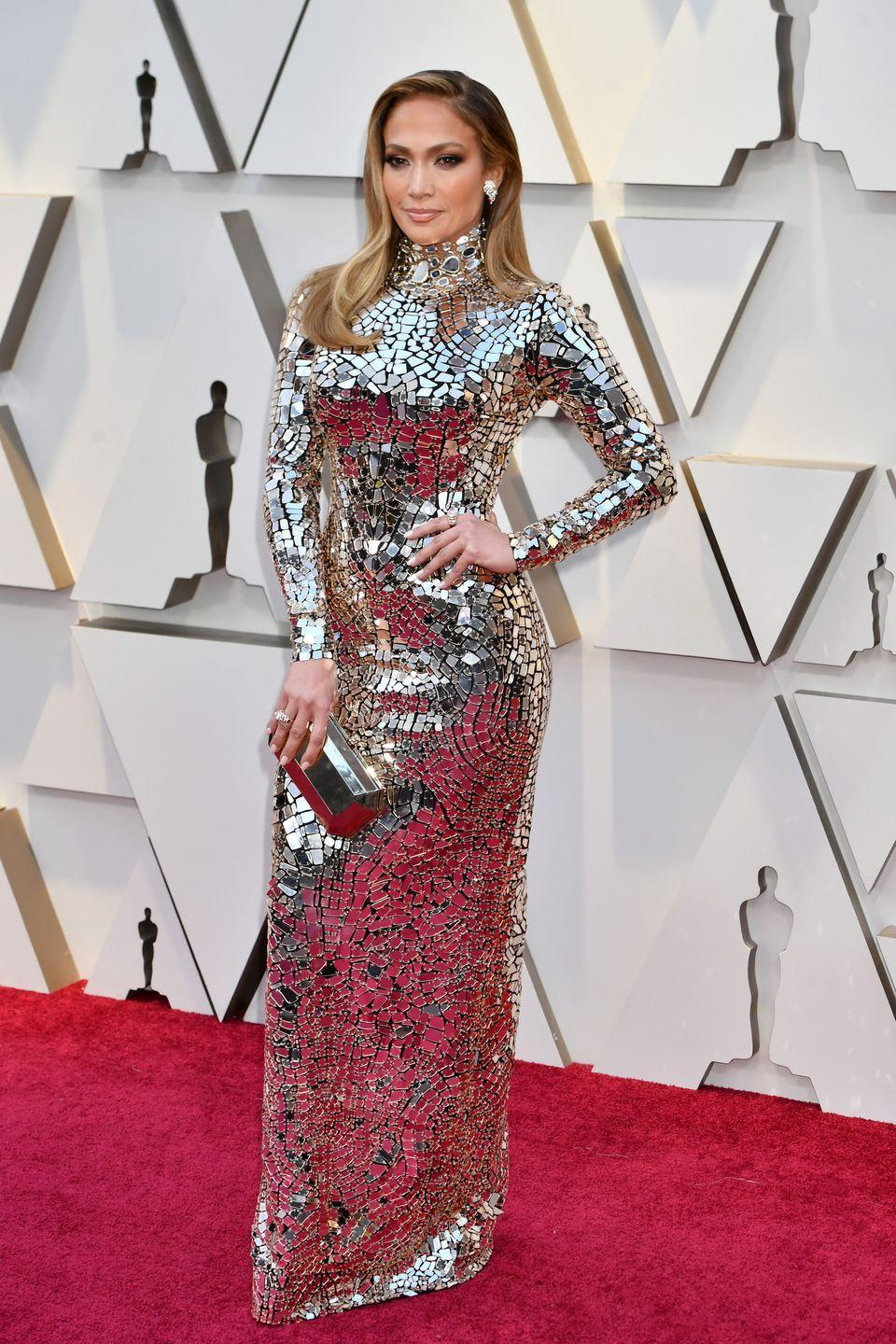 <p>A real-life disco glitterball in a high-kneck long-sleeve silver gown by Tom Ford.</p>