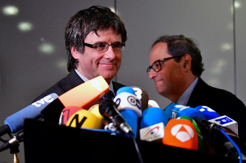 The newly elected Catalan regional president Quim Torra (R) and exiled ousted leader Carles Puigdemont attend a press conference in Berlin on May 15, 2018 (AFP Photo/Tobias SCHWARZ)
