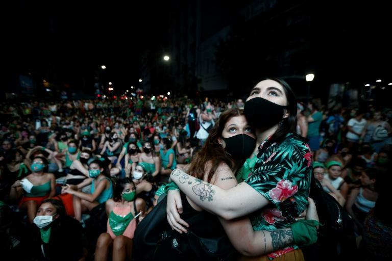 Thousands of pro-choice activists celebrated the vote on the streets of capital Buenos Aires