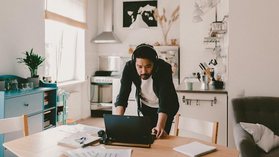 Photo series of japanese man working from home as a freelancer, making conference calls and discussing projects.