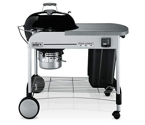 """<p><strong>Weber</strong></p><p>amazon.com</p><p><strong>$419.00</strong></p><p><a href=""""https://www.amazon.com/dp/B00N634UJK?tag=syn-yahoo-20&ascsubtag=%5Bartid%7C2089.g.36490432%5Bsrc%7Cyahoo-us"""" rel=""""nofollow noopener"""" target=""""_blank"""" data-ylk=""""slk:Shop Now"""" class=""""link rapid-noclick-resp"""">Shop Now</a></p><p>This Weber gives you everything you love about the classic charcoal grill, but with some add-ons that make it even better. There's a large work surface on its side, a convenient lid holder, and a pullout bin for storing charcoal. Its porcelain-enameled lid and bowl work wonders at retaining heat, too!</p>"""