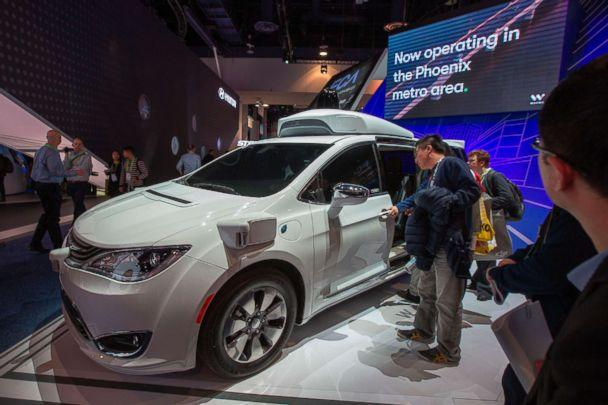 PHOTO: People look at the Waymo car, formerly the Google self-driving car project, during CES 2019 in Las Vegas, Jan. 9, 2019. (David McNew/AFP/Getty Images, FILE)