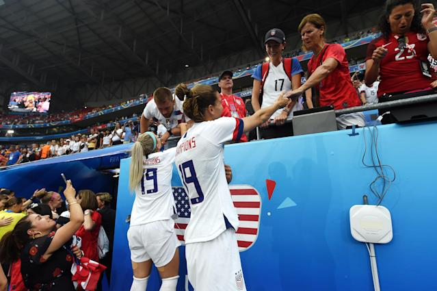 Julie Ertz and Tobin Heath celebrate victory with family and friends in the crowd after the 2019 FIFA Women's World Cup France Final match between The United States of America and The Netherlands at Stade de Lyon on July 07, 2019 in Lyon, France. (Photo by Alex Caparros - FIFA/FIFA via Getty Images)
