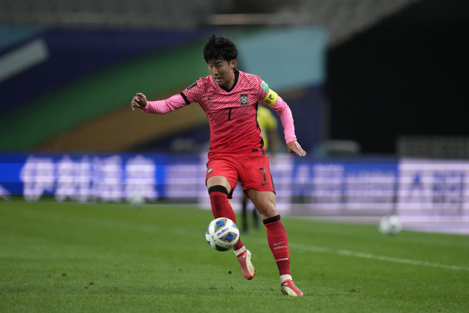 South Korea's Son Heung-min dribbles during the final round of their Asian zone group A qualifying soccer match between South Korea and Iraq for the FIFA World Cup Qatar 2022 at Seoul World Cup stadium in Seoul, South Korea, Thursday, Sept. 2, 2021. (AP Photo/Lee Jin-man)