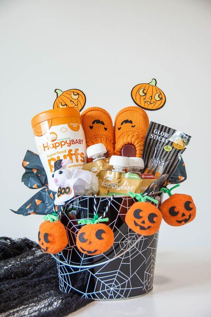 """<p>Just add some puffs, some pouches and some <a href=""""https://www.amazon.com/Newborn-Halloween-Pumpkin-Bootie-Infant/dp/B07G5CB27Y?tag=syn-yahoo-20&ascsubtag=%5Bartid%7C10055.g.34288815%5Bsrc%7Cyahoo-us"""" rel=""""nofollow noopener"""" target=""""_blank"""" data-ylk=""""slk:pumpkin booties"""" class=""""link rapid-noclick-resp"""">pumpkin booties</a> and you've got yourself a happy baby!</p><p><a href=""""https://sincerelymrssmith.com/2020/09/30/babys-first-halloween-boo-basket/"""" rel=""""nofollow noopener"""" target=""""_blank"""" data-ylk=""""slk:See more at Sincerely, Mrs. Smith »"""" class=""""link rapid-noclick-resp""""><em>See more at Sincerely, Mrs. Smith »</em></a></p>"""