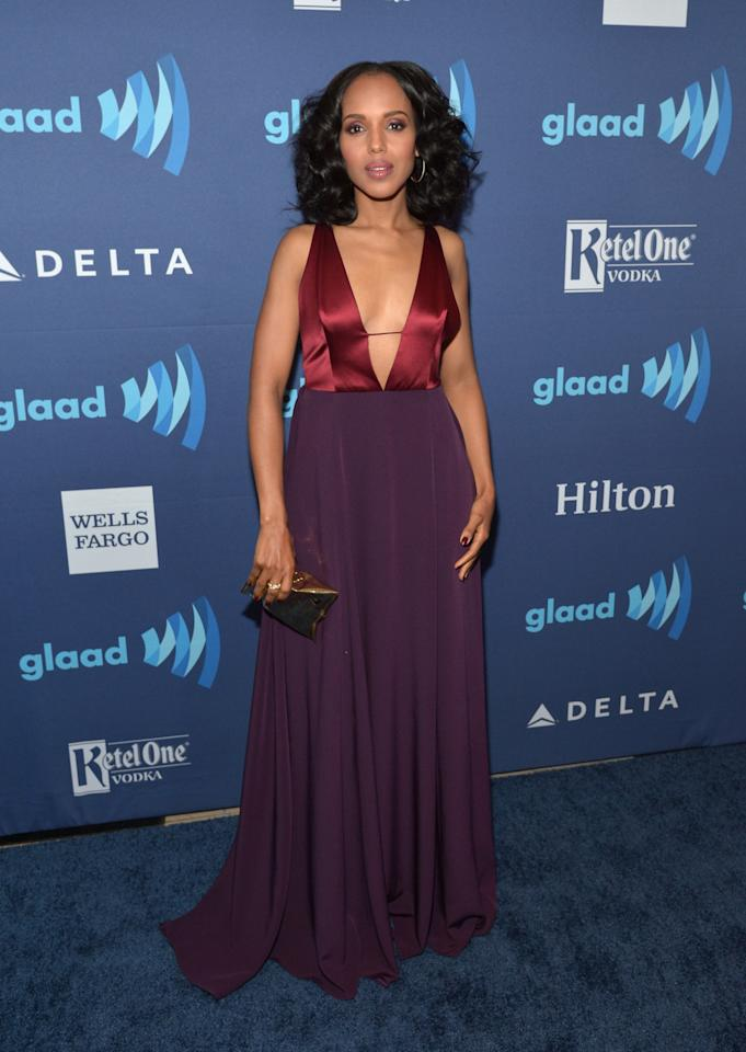 """The """"Scandal"""" actress, who received the 2015 Vanguard Award, stunned in a maroon and eggplant floor-length dress with a dangerously low neckline."""