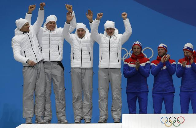 Medals Ceremony - Cross-Country Skiing - Pyeongchang 2018 Winter Olympics - Men's 4x10 km Relay - Medals Plaza - Pyeongchang, South Korea - February 18, 2018 - Silver medalists Andrey Larkov, Alexander Bolshunov, Alexey Chervotkin and Denis Spitsov, Olympic athletes from Russia on the podium. REUTERS/Eric Gaillard