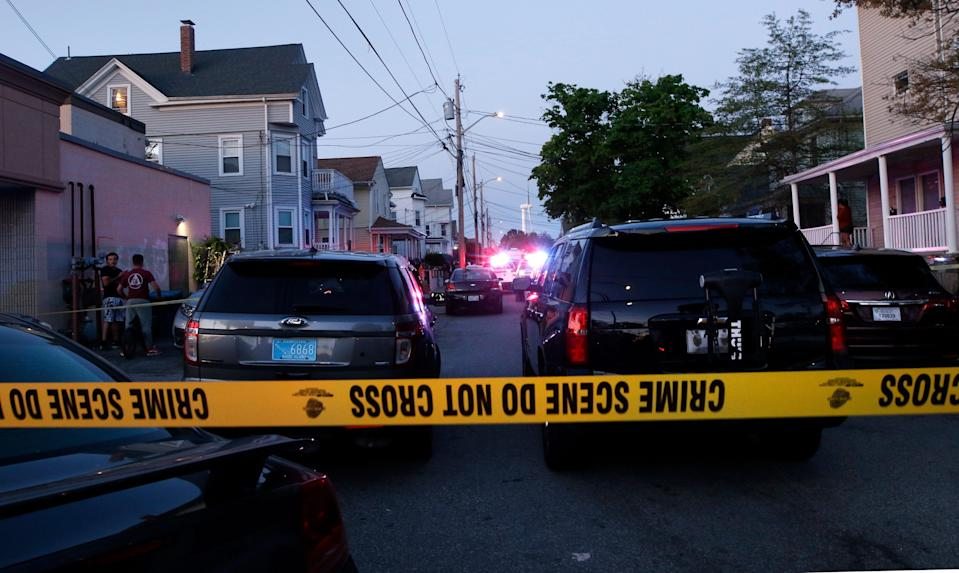 Providence, RI, May 13, 2021 - Providence police investigate the scene were nine people were shot near 87 Carolina St. in Providence around 6:47pm on Thursday evening.  [The Providence Journal / Kris Craig]