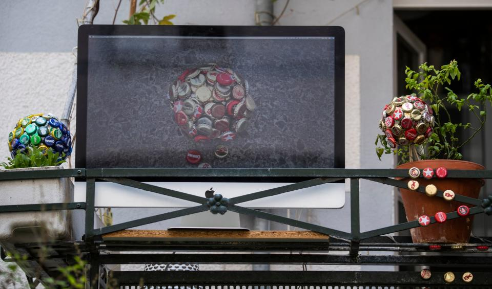 """An art installation featuring a video screen, part of the """"Balconies, Life, Art, Pandemic, and Proximity"""" exhibition, is seen in Berlin on April 12, 2020, amid a new coronavirus COVID-19 pandemic. - Over 30 artists are taking part in the two-day exhibition which calls on """"the artistic community living in [Berlin's district of] Prenzlauer Berg to activate / exhibit / inhabit / their windows and balconies on Easter Sunday and Monday"""". Curated by Ovul Durmusoglu and Joanna Warsza, the exhibition boasts """"zero budget, no openings, no crowds, just a proposition of a stroll that would connect dots in solidarity and togetherness"""". (Photo by John MACDOUGALL / AFP) (Photo by JOHN MACDOUGALL/AFP via Getty Images)"""