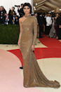 """<p>We love a good costume and Zendaya definitely committed to the <a href=""""https://www.cosmopolitan.com/uk/fashion/celebrity/news/g4449/met-gala-2016-manus-machina-fashion-dresses/"""" rel=""""nofollow noopener"""" target=""""_blank"""" data-ylk=""""slk:2016 Met Gala"""" class=""""link rapid-noclick-resp"""">2016 Met Gala</a> theme (Manus x Machina) in this shimmering gold one-shoulder Michael Kors gown, complete with an edgy bowl cut.</p>"""